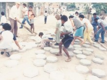 Community effort to pave Margaridas Street, Diadema, Brazil, 1990.