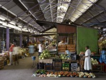 Fresh produce stalls in the renovated heritage building that houses the Early Morning Market, Durban, South Africa.
