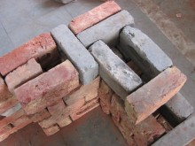 Modified rat trap bond brick walls provide better thermal quality than normal brick walls and improved stability during earthquakes.