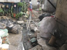 Unsanitary conditions prior to upgrading, Barangay Pag-asa informal settlement, Binangonan, Rizal province, Philippines.