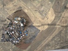 Residents' aerial snapshots are stitched together and overlaid on a Google satellite map.