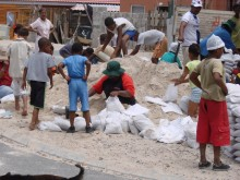 Freedom Park residents fill sandbags.
