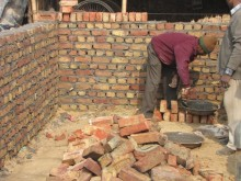 Resident builds a house using rat trap bond brick-laying technique, requiring 50% less cement mortar and 30% less brick, resulting in 25% cost savings.