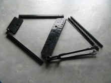 Metal bicycle module components. Numerous hole sizes and locations provide flexibility in attachment points.
