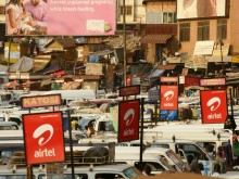 Mobile phone kiosks throughout urban Uganda.