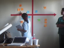 A nurse in Quito, Ecuador, mapping out prototype ideas on a global health innovation compass chart.