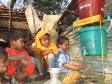 Children get clean drinking water from the SONO water filter, Naltona, Barguna district, Bangladesh.