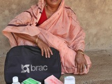 A health volunteer with kit, Bangladesh.