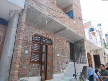 Design Home Solutions: upgraded house, Mangolpuri slum resettlement colony, New Delhi, India.